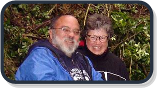 Photo of Steve Carballeira and Elaine Head standing in the rain forest on a chilly day.